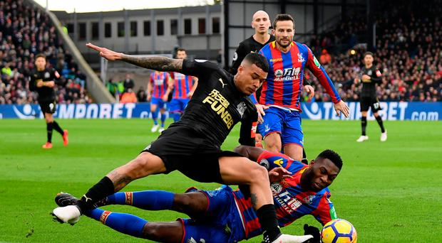Crunch: Newcastle's Kenedy is challenged by Timothy Fosu-Mensah