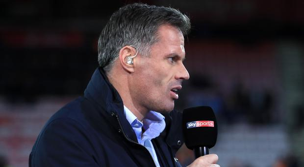 Jamie Carragher appeared to spit at Manchester United fans