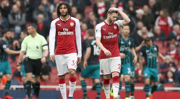 Arsenal's Mohamed Elneny, left, was sent off against Southampton