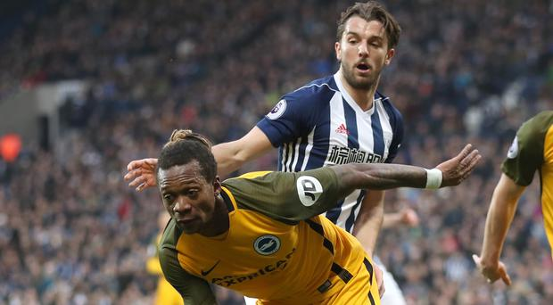 West Brom's Jay Rodriguez, pictured right, has been cleared of racially abusing Brighton's Gaetan Bong