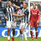 Salomon Rondon, left, celebrates his late equaliser with fellow goalscorer Jake Livermore