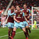 Ashley Barnes (centre) dealt Stoke's survival hopes another blow with the equaliser for Burnley