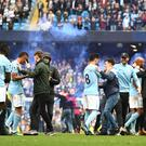 Manchester City fans and players celebrate