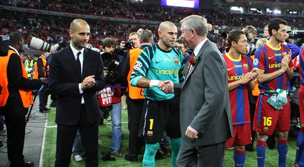 Sir Alex Ferguson (right) congratulates Pep Guardiola after his Barcelona side beat United in the 2011 Champions League final