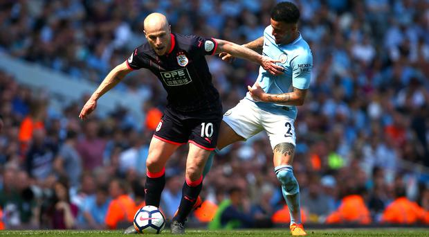 Aaron Mooy, left, helped Huddersfield to a well-earned point
