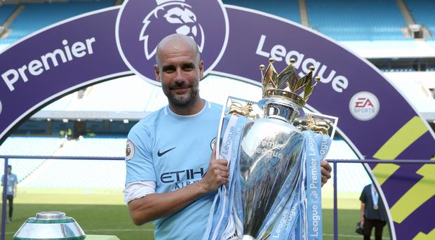 Pep Guardiola got his hands on the Premier League trophy (Martin Rickett/PA)