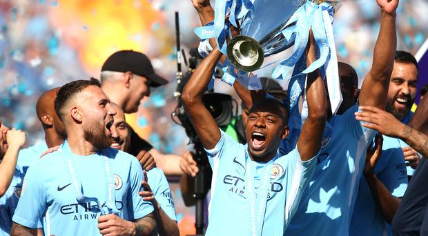 Manchester City celebrated with the Premier League trophy on Sunday