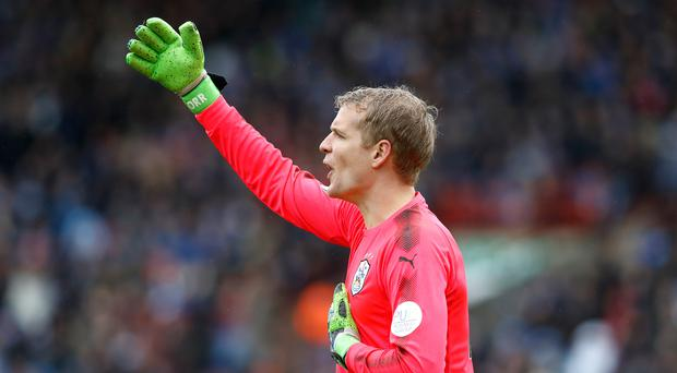 Jonas Lossl helped Huddersfield claim an important point at Manchester City
