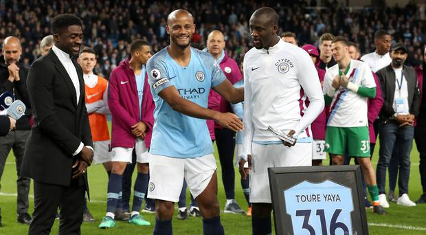 Kolo Toure and Vincent Kompany presented Yaya Toure with a plaque after his final home game for Manchester City