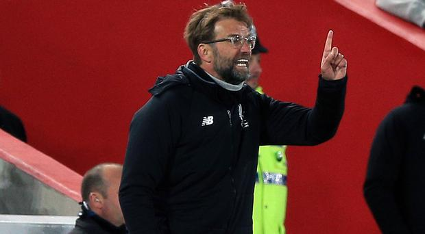 Jurgen Klopp's Liverpool side need a point at home to Brighton to effectively secure Champions League football next season