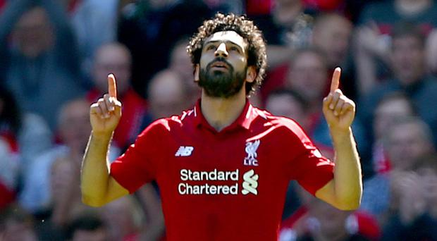Mohamed Salah celebrates his record-breaking goal