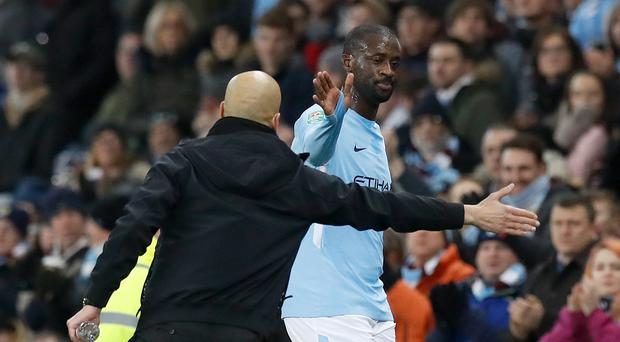 Yaya Toure, right, shakes hands with Pep Guardiola (Martin Rickett/PA)