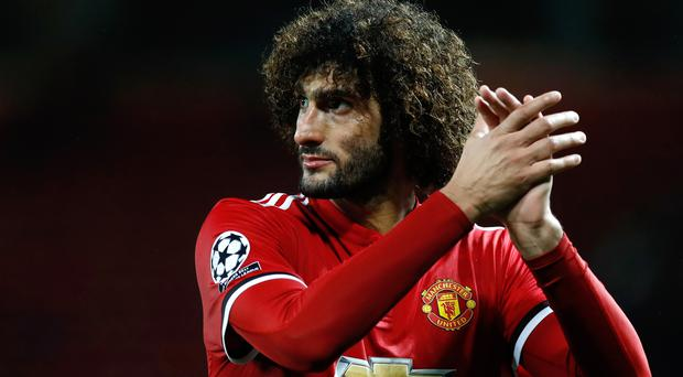 Midfielder Marouane Fellaini has signed a new two-year contract with Manchester United (Credit: Martin Rickett/PA)