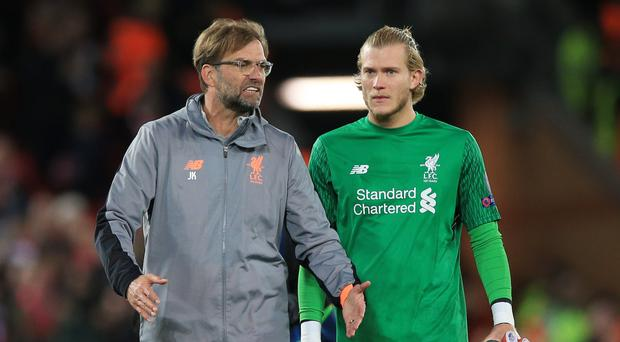 Liverpool manager Jurgen Klopp, left, insists goalkeeper Loris Karius starts this season with a clean slate (Peter Byrne/PA)