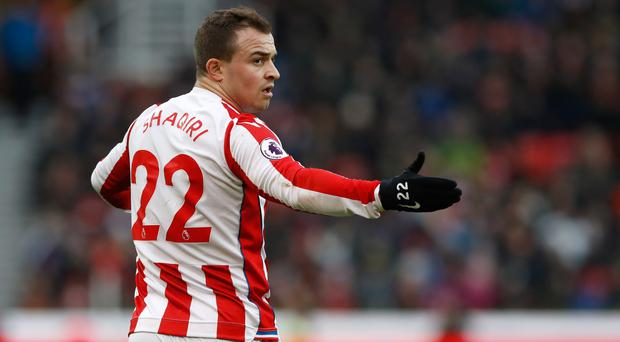 Liverpool have opened negotiations with Stoke over a deal for winger Xherdan Shaqiri (Martin Rickett/PA).