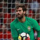 Liverpool have smashed the world transfer record for a goalkeeper to sign Roma's Alisson (Mike Egerton/PA)