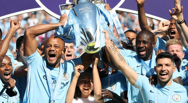 Vincent Kompany (left) believes Manchester City can make a strong title defence (Martin Rickett/PA)