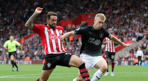 Southampton's Danny Ings (left) and Burnley's Ben Mee battle for the ball during the Premier League match at St Mary's, Southampton.