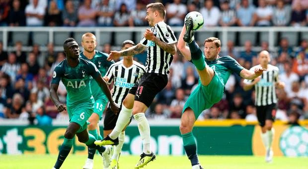 Best foot forward: Jan Vertonghen claims the ball from Joselu