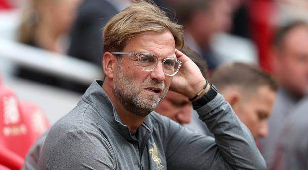 Liverpool manager Jurgen Klopp admits tougher tests await his side after an opening 4-0 win (David Davies/PA).