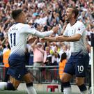 Harry Kane, right, celebrates scoring his first ever Premier League goal in August (Nick Potts/PA)