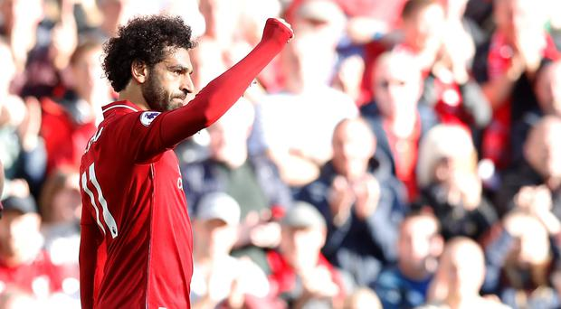 Mohamed Salah celebrates after scoring Liverpool's winner (Martin Rickett/PA)