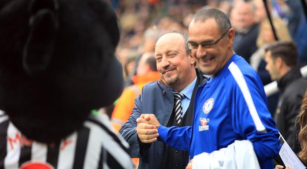 Chelsea manager Maurizio Sarri, right, shakes hands with Newcastle counterpart Rafael Benitez before the game (Owen Humphreys/PA)