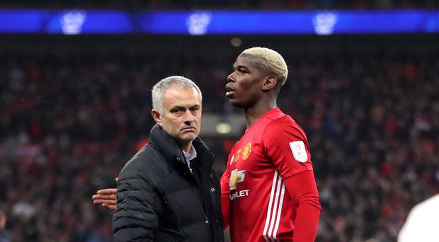 Manchester United manager Jose Mourinho and Paul Pogba after the EFL Cup Final at Wembley Stadium, London.