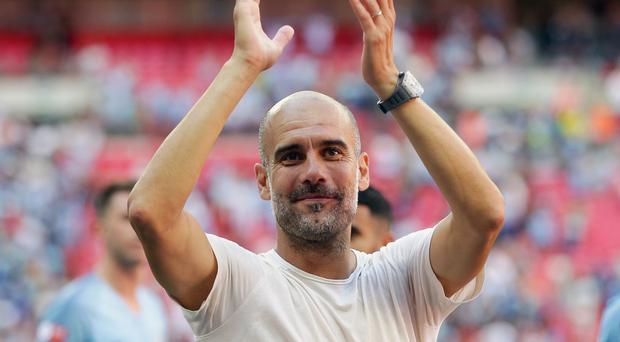 Manchester City boss Pep Guardiola has a desire to manage in international football (Adam Davy/PA)