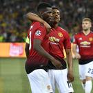 Paul Pogba, left, scored twice for Manchester United in Switzerland (Anthony Anex/AP)