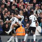 Fulham's Aleksandar Mitrovic (centre) celebrates scoring his side's first goal of the game during the Premier League match at Craven Cottage, London.