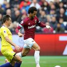 Chelsea's Cesar Azpilicueta, left, challenges Felipe Anderson for the ball (Tim Goode/PA)
