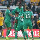 Watford celebrates Etienne Capoue's opener at Wolves. (Nick Potts/PA)