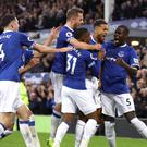 Everton's Dominic Calvert-Lewin (second right) celebrates scoring his side's first goal of the game with team-mates during the Premier League match at Goodison Park, Liverpool.
