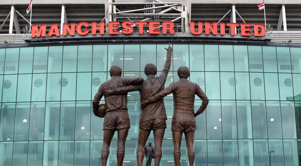 Manchester United announced reduced quarterly income (Anthony Devlin/PA)
