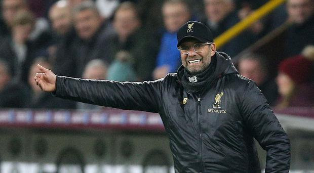 Liverpool manager Jurgen Klopp does not expect Manchester City to buckle under their pressure (Nigel French/PA).