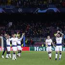 Tottenham players salute their fans after the game with Barcelona (Manu Fernandez/AP).