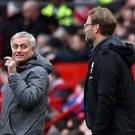 Jose Mourinho, left, and Jurgen Klopp will pit their wits against each other again on Sunday (Martin Rickett/PA)
