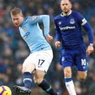 Kevin De Bruyne (left) has no reason to doubt Liverpool will maintain their challenge (Martin Rickett/PA)
