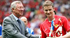 There is a close link between Solskjaer and Ferguson (Clint Hughes/PA)