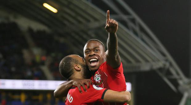 Michael Obafemi is held aloft by Nathan Redmond after scoring his first Southampton goal (Richard Sellers/PA)