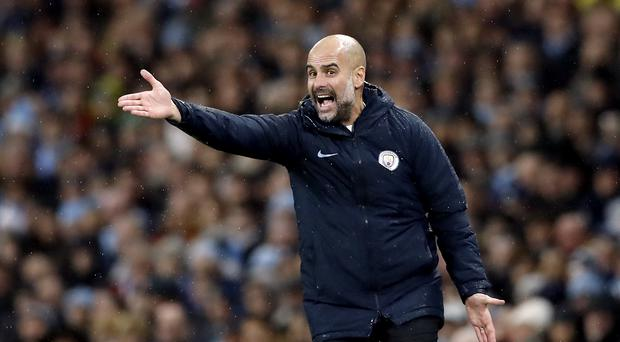 Pep Guardiola defended his team selection after Manchester City were beaten by Crystal Palace (Martin Rickett/PA)