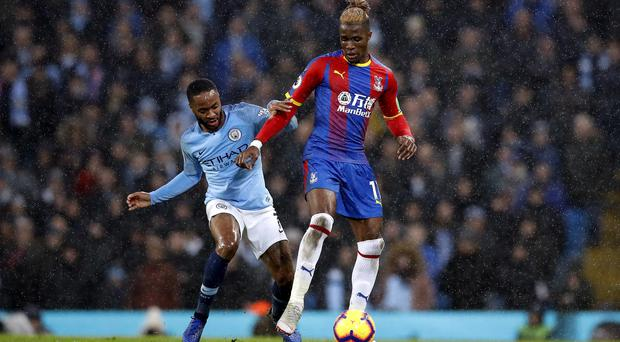 Crystal Palace's Wilfried Zaha could be in line for a big-money move in China, reports say (Martin Rickett/PA)