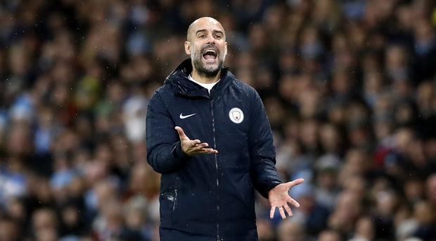 Pep Guardiola says Liverpool must deal with expectations (Martin Rickett/PA)