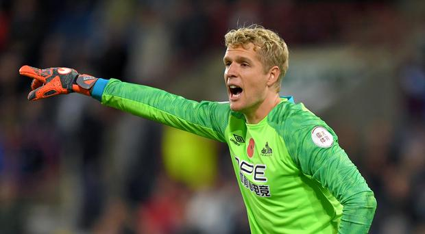 Huddersfield Town goalkeeper Jonas Lossl wants to keep same brave spirit shown against Manchester United (Dave Howarth/PA)