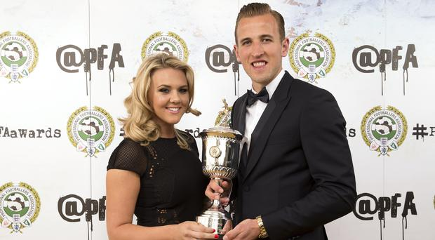 Harry Kane pictured with his fiancee Kate Goodland (Barrington Coombs/PA)