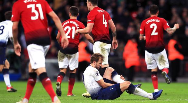 Harry Kane, centre right, suffered an ankle injury against Manchester United (Mike Egerton/PA)