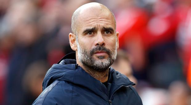 Pep Guardiola is unsure what to expect from Huddersfield (Martin Rickett/PA)