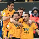 Wolves' Diogo Jota (far right) celebrates the first goal of his hat-trick against Leicester (Mike Egerton/PA)