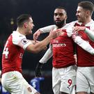 Arsenal's Alexandre Lacazette, centre, celebrates scoring the opener against Chelsea (Nick Potts/PA)